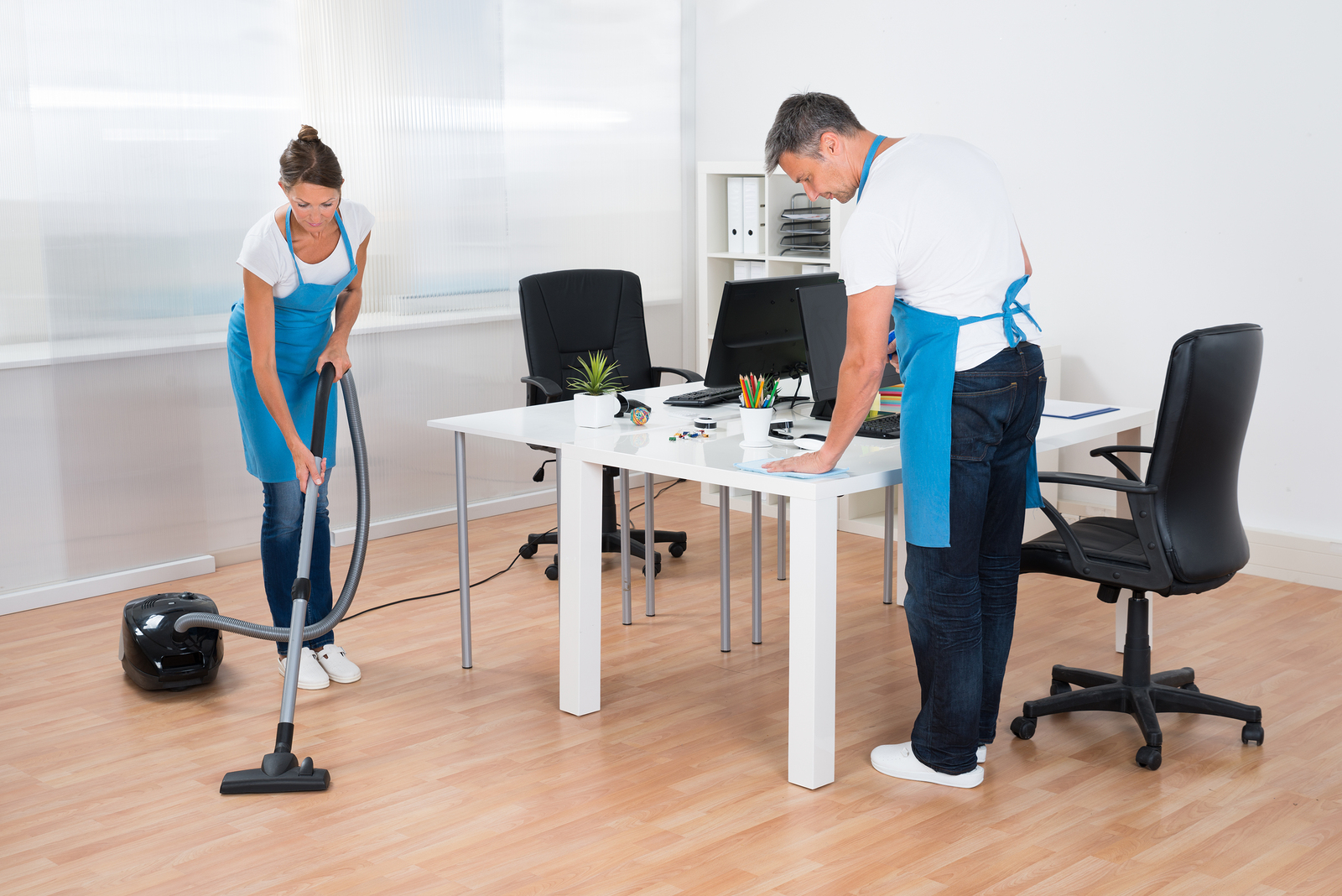 Two Professional Janitors Are Cleaning The Modern Office